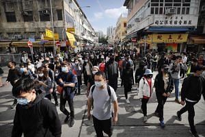 "Protesters march during a demonstration against ""parallel traders"" who buy goods in Hong Kong to resell in mainland China in Sheung Shui, near the Chinese border in Hong Kong on Jan 5, 2020."