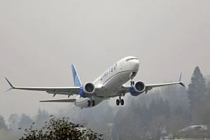 A United Airlines airplane taking off at Renton Municipal Airport in Washington.