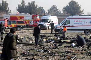 Rescue teams work amid debris in Teheran on Jan 8, 2020.