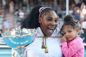 Serena Williams, 38, with her two-year-old daughter Olympia after her win against fellow American Jessica Pegula in yesterday's Auckland Classic final. It was Williams' 73rd career title but the first time she has lifted a trophy since giving birth.