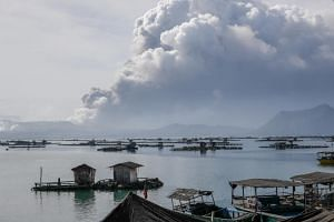 Ash spews into the air from the Taal Volcano in Talisay, Philippines, on Jan 13, 2020.