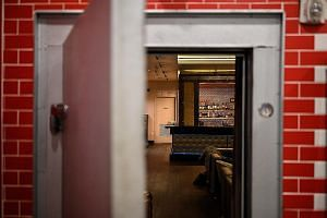 The discreet entrance of the Capo bar and club is open inside a deli shop in Washington,DC.