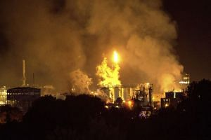 Smoke rise following a big explosion at an industrial hub near the port city of Tarragona, Spain.