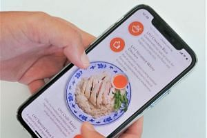 Chicken rice hawker Lao Hung Jia's revenue grew by half after launching a website and mobile app for online orders. PHOTO: GETTY IMAGES
