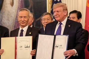 Chinese Vice-Premier Liu He (left) and US President Donald Trump pose after signing the Phase One trade deal.