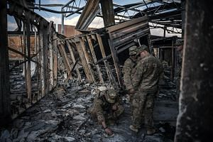 US military personnel on Monday surveying the damage to a building at Al-Asad air base in Anbar, Iraq, that was struck by Iranian missiles last week. With the heightened tensions, US troops in the country have switched their focus to defending Americ
