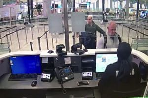 Michael Taylor (right) and George Antoine Zayek at passport control in Istanbul Airport.