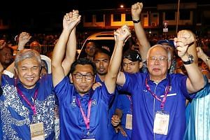 Barisan Nasional candidate Datuk Mohamad Alamin (centre) celebrating the opposition coalition's victory in Kimanis by-election in Sabah, flanked by former premier Najib Razak (right) and Umno president Ahmad Zahid Hamidi (left). PHOTO: THE STAR/ASIA