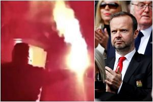 A video posted on social media showed a group gathered outside the house of Manchester United executive vice-chairman Ed Woodward, chanting threats and throwing red flares.