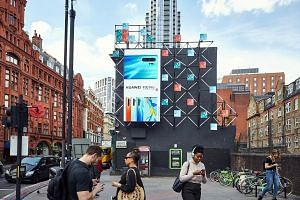 A Huawei advertisement in London. Banning Huawei, which has about a third of the US$50 billion (S$68 billion) global telecoms equipment market, would have ramifications for the pace of the 5G rollout, says the writer.