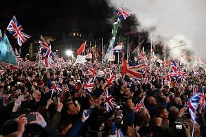 Brexit supporters waving Union Jacks in Parliament Square on Friday night to celebrate Britain's departure from the European Union after 47 years. Proponents of Brexit hope that it will herald reforms to reshape Britain and propel it ahead of its Eur