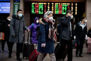 Passengers arriving from different provinces in China at the Beijing Railway Station on Feb 1, 2020.