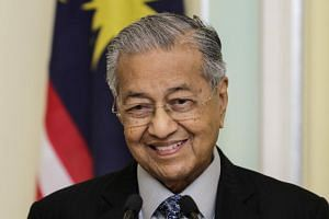Almost immediately after he was installed as Prime Minister, questions were raised over whether  Prime Minister Mahathir Mohamad (pictured) would eventually hand the reins to former nemesis Mr Anwar Ibrahim.