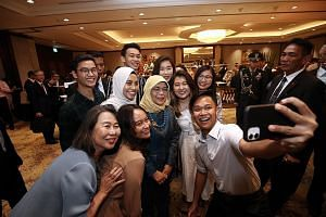 Ngee Ann Polytechnic students on internships with Indonesian companies taking a wefie with President Halimah Yacob at her reception with the Singapore community in Jakarta during her state visit to Indonesia. PHOTO: LIANHE ZAOBAO