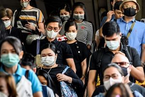 People at a city commuter train station in Bangkok on Jan 31, 2020. The virus outbreak has delivered a severe blow to Thailand's tourism industry, undermining the outlook for the economy.