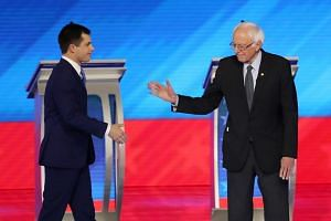 Former Mayor Pete Buttigieg (left) of South Bend, Indiana, and Senator Bernie Sanders of Vermont before the start of the Democratic presidential primary debate in Manchester, New Hampshire.