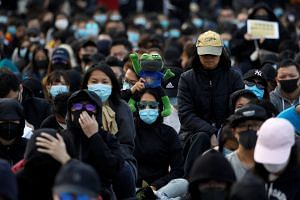 Anti-government protesters demonstrate during a protest at Edinburgh Place in Hong Kong, China, on Jan 12, 2020.