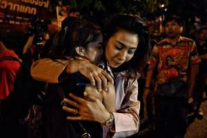 People hug each other after being rescued by Thai commandos.
