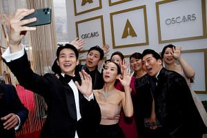 The cast of Parasite pose for a selfie during the Oscars arrivals at the 92nd Academy Awards in Hollywood on Feb 9, 2020.