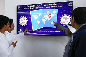 Kuwaiti students watching a video on coronavirus infection. The country has issued an advisory against travel to Singapore. PHOTO: AGENCE FRANCE-PRESSE