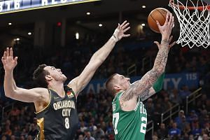 Boston starter Gordon Hayward sinking two of his 13 points of the night past Oklahoma City's Danilo Gallinari during their NBA game at Chesapeake Energy Arena on Sunday. Celtics extended their winning streak to seven games after the 112-111 triumph.