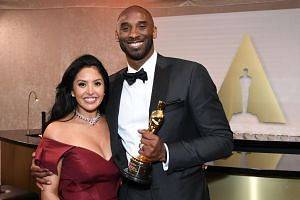 In a photo taken on Mar 4, 2018, US actor and basketball player Kobe Bryant (right) and his wife Vanessa Bryant attend the 90th Annual Academy Awards Governors Ball in Hollywood.