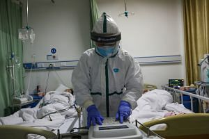 A medical worker in a protective suit at an isolated ward of a hospital in Caidian, China, on Feb 6, 2020.