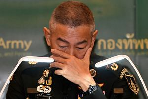 Thai army chief Apirat Kongsompong apologises during a news conference in Bangkok, following a shooting rampage by a soldier at a mall in the city of Nakhon Ratchasima, on Feb 11, 2020.
