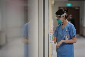 A NCID nurse clad in N95 mask and goggles on Feb 14, 2020.