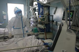 In a photo taken on Feb 13, 2020, a medical worker is seen at the intensive care unit of Jinyintan hospital in Wuhan, China.