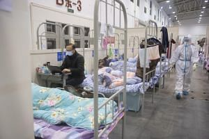 Coronavirus-infected patients inside the Wuhan Fang Cang makeshift hospital in Wuhan, on Feb 17, 2020.