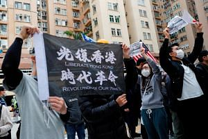 Residents wear masks as they march to protest against the government's plan to set up a quarantine site close to their community amid the Wuhan outbreak, in Hong Kong, on Feb 2, 2020.