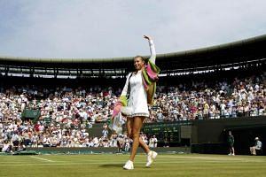 Russia's Maria Sharapova celebrates victory in England on June 27, 2005.