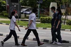In a photo taken on Jan 28, 2020, medical staff are seen wearing masks around the premises of the National Centre for Infectious Diseases.