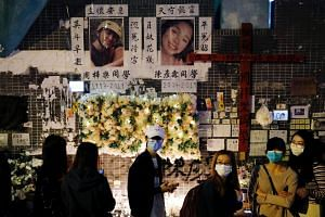 Anti-government protesters attending a vigil to mourn a student's death, in Hong Kong on March 8, 2020.