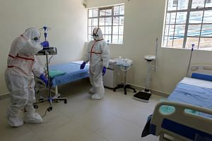 Nurses wearing protective gear prepare an isolation ward at Mbagathi Hospital in Nairobi on March 6, 2020.