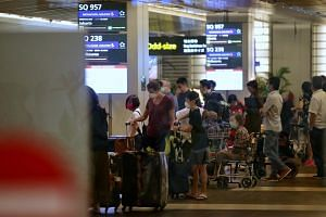 Travellers arriving at Changi Airport on March 16, 2020. Singapore has announced additional entry restrictions into the Republic in a move to reduce the number of imported Covid-19 cases.