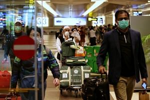 People arriving at Changi Airport on March 16, 2020. In line with recent trends, 33 of the new cases are imported and 30 of them involve Singapore residents returning from abroad.
