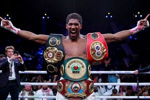 Anthony Joshua celebrates winning his fight against Andy Ruiz Jr in December 2019.