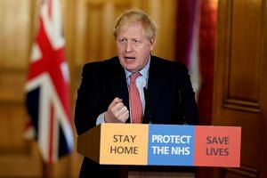 British Prime Minister Boris Johnson speaks during his first remote news conference on the coronavirus outbreak, in London, Britain, on March 25, 2020.