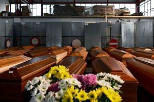 A general view shows some of 35 coffins of deceased people stored in a warehouse in Ponte San Pietro, near Bergamo, Lombardy, on March 26, 2020, prior to be transported in another region to be cremated.