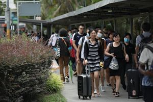 Ccommuters near the Woodlands Train Checkpoint heading to Malaysia on March 17, 2020.