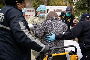 Paramedics transport a patient with Covid-19 symptoms to a hospital on April 17, 2020 in Yonkers, New York.