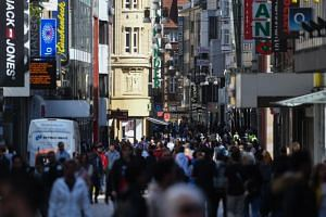 Crowds are seen in Dortmund, Germany, after some shops were allowed to reopen, on April 20, 2020.