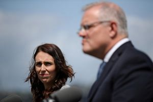 New Zealand Prime Minister Jacinda Ardern (left) and Australia's Scott Morrison are both succeeding with throwback democracy.