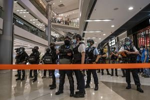 RIot police stand guard in a mall in Hong Kong on April 28, 2020.