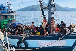 A wooden boat carrying Rohingya migrants being detained off the island of Langkawi in April 2020.