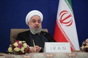 A photo taken on May 4, 2020, shows President Hassan Rouhani at a televised video conference meeting in Teheran.