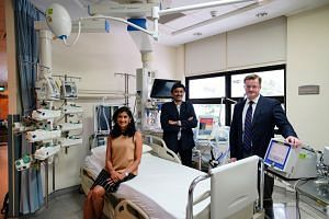 (From left) Dr Jyoti Somani, an infectious disease doctor, and Dr Kollengode Ramanathan and Dr Graeme MacLaren, who are ICU specialists. PHOTO: NUHS