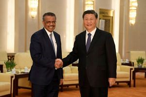 World Health Organisation director-general Tedros Adhanom Ghebreyesus with Chinese President Xi Jinping in Beijing on Jan 28, 2020.
